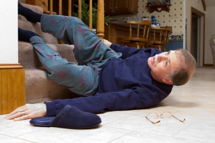 man slipping and falling down stairs