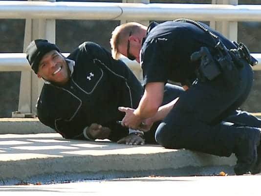 injured man getting help from officer
