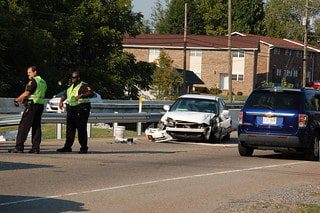 traffic accident involving a white vehicle hitting median