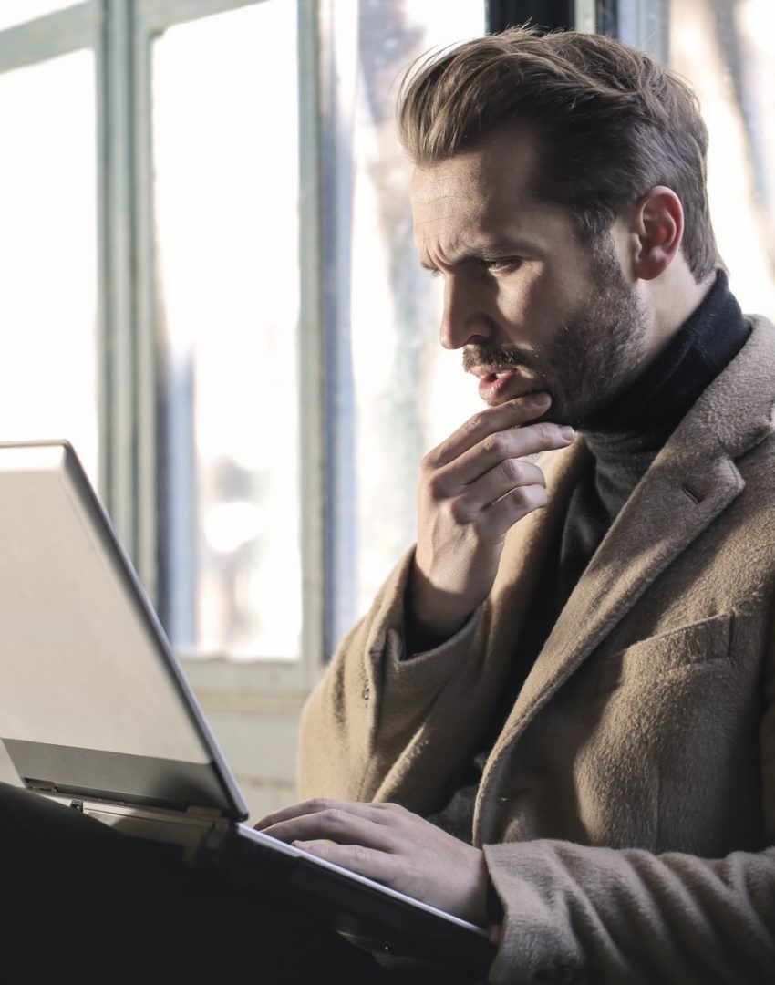 man looking at computer confused