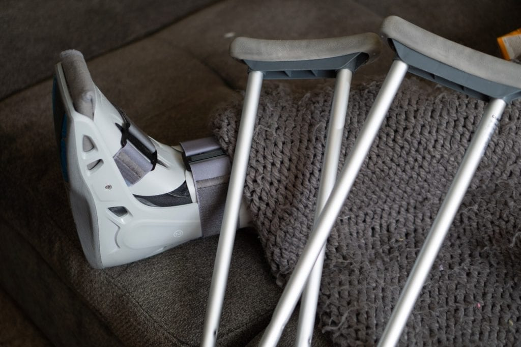 crutches resting on foot in boot